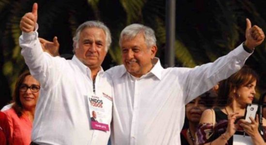 Miguel Torruco and AMLO celebrating thier victory.
